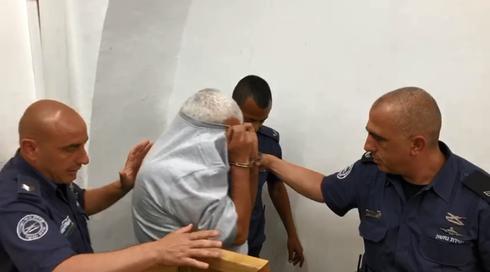 מרדכי מוגזמוף בעת המעצר. צילום: לירן תמרי